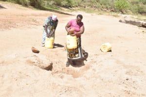 The Water Project: Kyamwalye Community -  Fetching Water