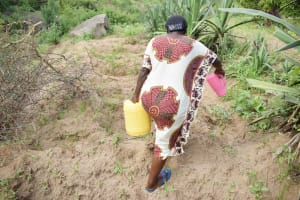 The Water Project: Mbiuni Community C -  Carrying Water