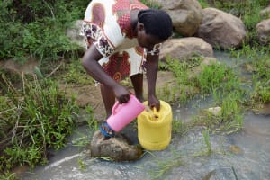 The Water Project: Mbiuni Community C -  Collecting Water