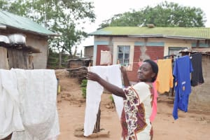 The Water Project: Mbiuni Community C -  Hanging Clothes To Dry