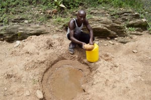 The Water Project: Yumbani Community B -  Filling Up Container