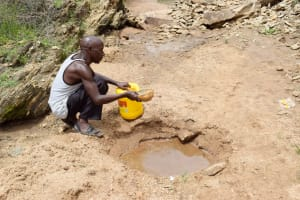 The Water Project: Yumbani Community B -  Collecting Water At The Scoop Hole