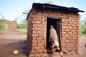 The Water Project: Yumbani Community C -  Walking Into Kitchen