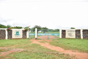The Water Project: Nzoila Secondary School -  Entrance And Sign
