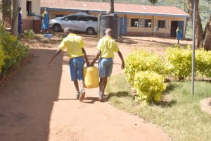 The Water Project: AIC Kaseve Primary School -  Carrying Water