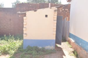 The Water Project: AIC Kaseve Primary School -  Staff Latrines