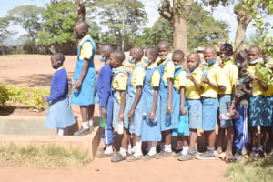 The Water Project: AIC Kaseve Primary School -  Students Lined Up At Small Tank