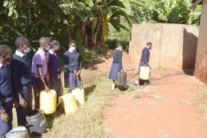 The Water Project: Utuneni Secondary School -  Students Carrying Water