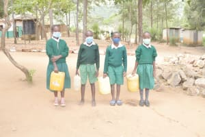 The Water Project: Kitondo Primary School -  Students With Water Containers