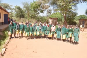 The Water Project: Itulu Primary School -  Students Hold Water Containers