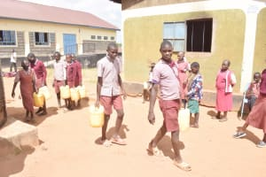 The Water Project: Kako Special School for the Mentally Handicapped -  Students Carrying Water
