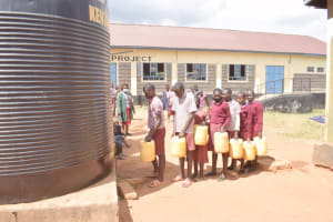 The Water Project: Kako Special School for the Mentally Handicapped -  Students Fill Up At Small Rain Tank