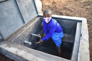 The Water Project: St. Peter's Ebunga'le Primary School -  Pupil Handwashing At The Rain Tank
