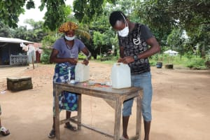 The Water Project: Lungi, New London, Saint Dominic's Catholic Church -  Participants Constructing Tippy Taps