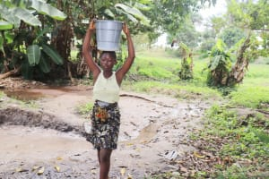 The Water Project: Lungi, Yongoroo, #7 Kamara Taylor Street -  Small Girl Carrying Water