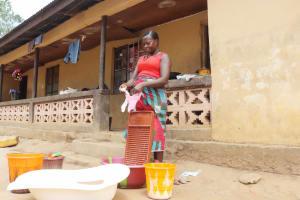 The Water Project: Lungi, Yongoroo, #7 Kamara Taylor Street -  Woman Laundering