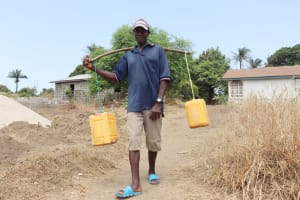The Water Project: Lungi, Yongoroo, #7 Kamara Taylor Street -  Young Man Selling Palm Wine