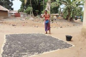 The Water Project: Lungi, Yongoroo, #7 Kamara Taylor Street -  Woman Processing Black Sand