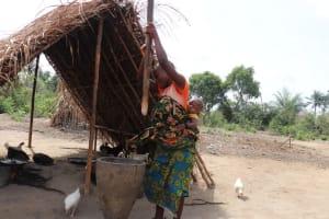 The Water Project: Kamasondo, Bross 2 -  Young Woman Pounding Rice