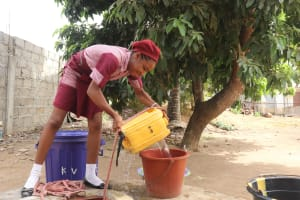 The Water Project: Masoila Jesus is the Way School -  Pupil Collecting Water