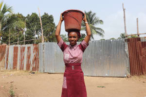 The Water Project: Masoila Jesus is the Way School -  Pupils Carrying Water
