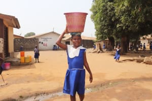 The Water Project: Masoila Gateway Baptist Church and Primary School -  Student Carrying Water