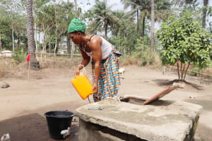 The Water Project: Waysaya Community, #1 Reverend Samuel Street -  Collecting Water At Open Well