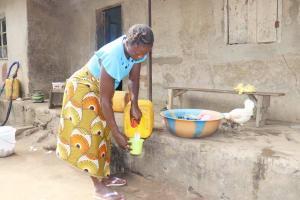 The Water Project: Waysaya Community, #1 Reverend Samuel Street -  Woman Selling Palm Wine