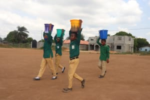 The Water Project: Kulafai Rashideen Primary School -  Students Carrying Water