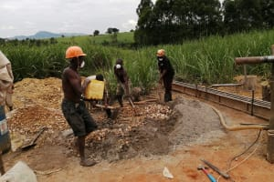 The Water Project: Rubona Kyawendera Community -  Beginning Well Pad Construction