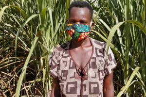 The Water Project: Rubona Kyawendera Community -  Charity Businge