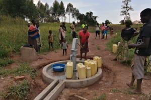The Water Project: Ejinga Taosati Community -  Fetching Water At The Well