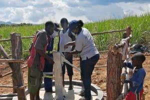 The Water Project: Rubona Kyawendera Community -  Finishing Pump Installation