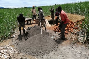 The Water Project: Rubona Kyawendera Community -  Mixing Cement
