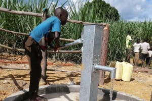 The Water Project: Rubona Kyawendera Community -  Water Flowing