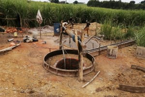 The Water Project: Rubona Kyawendera Community -  Well Apron Set Up