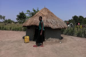 The Water Project: Rwensororo Community -  Standing Next To Kitchen