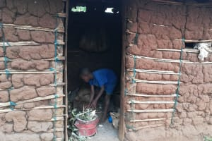 The Water Project: Bulima-Kahembe Community -  Child Cleaning The Kitchen