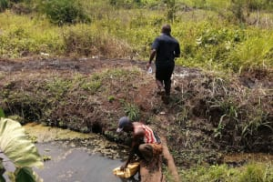 The Water Project: Bulima-Kahembe Community -  Collecting Water At The Open Source