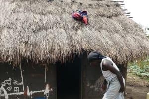 The Water Project: Bulima-Kahembe Community -  Walking Into Kitchen