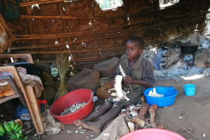 The Water Project: Byerima Community -  Child Cutting Food