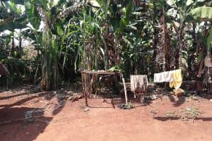 The Water Project: Byerima Kyakabasarah Community -  Clothesline Next To Dishrack