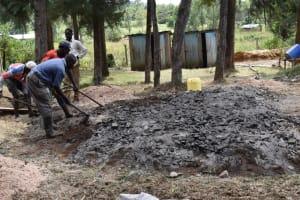 The Water Project: Wavoka Primary School -  Mixing Concrete