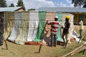The Water Project: Wavoka Primary School -  Tying Sacks To Wire