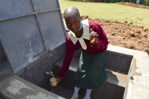 The Water Project: Wavoka Primary School -  Collecting Water At The Tank