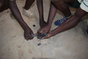 The Water Project: Wavoka Primary School -  Crushing Charcoal For Toothpaste Alternative