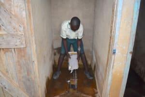 The Water Project: Wavoka Primary School -  Disinfecting Latrine Practicals
