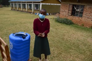 The Water Project: Wavoka Primary School -  Ruth Demonstrating Handwashing