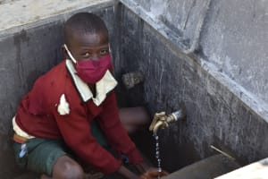 The Water Project: Wavoka Primary School -  Enjoying Water From The Tank