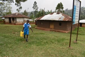 The Water Project: Friends Mudindi Village Primary School -  Carrying Water